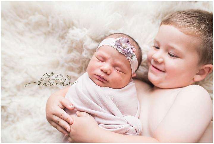 Newborn Sibling Poses with 2 Year Old